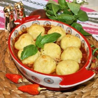 Potato gnocchi under meat sauce Roman style