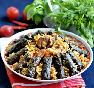 Pilaf with dolma (stuffed grape leaves)