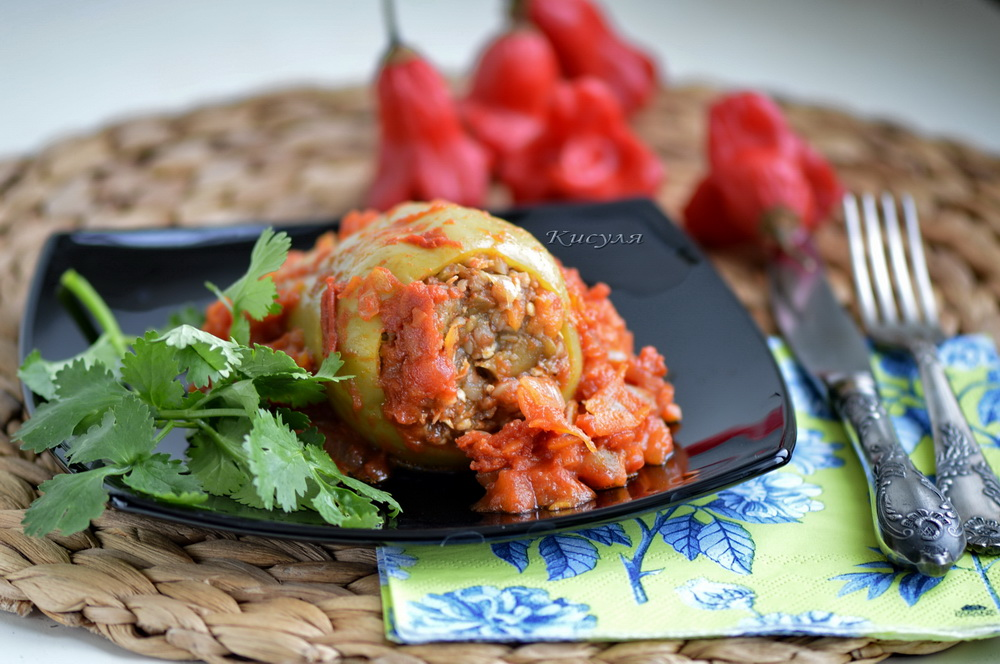 Peppers stuffed with buckwheat, mushrooms and cheese